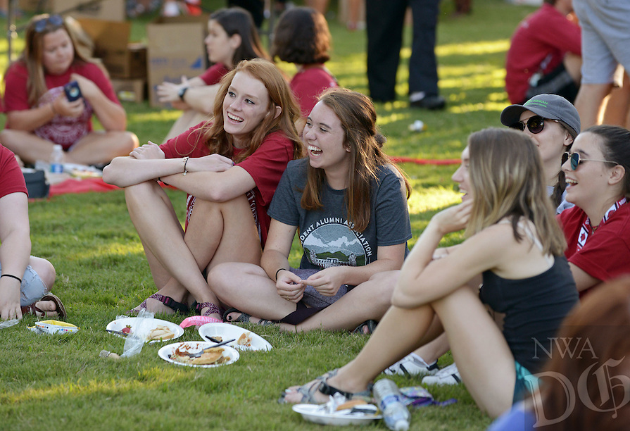 NWA Democrat-Gazette/BEN GOFF @NWABENGOFF<br /> Hannah Bond (left) and Ansley Fox, freshmen from Springfield, Mo., picnic on the Old Main lawn on Sunday Aug. 21, 2016 during the New Student Welcome and Burger Bash event on Old Main Lawn on the University of Arkansas campus in Fayetteville.