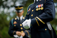 Soldiers with 3rd U.S. Infantry Regiment (The Old Guard) at Ft. Myer, Va., finish preparing their uniforms before a funeral at Arlington National Cemetery, May 18th, 2010. It can take up to six hours to get their uniforms ready from scratch for ceremonial duties.