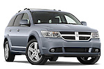 Low aggressive passenger side front three quarter view of a 2009 Dodge Journey.
