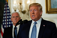 United States President Donald J. Trump makes a statement at the White House in Washington, DC in response to two separate shooting incidents,  August 5, 2019. US Vice President Mike Pence looks on from left. <br /> CAP/MPI/RS<br /> ©RS/MPI/Capital Pictures