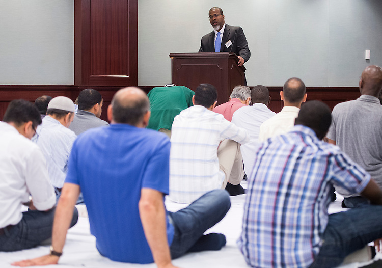 UNITED STATES - JULY 11: Jameel Johnson speaks during the Congressional Muslim Staff Association's Friday prayer, which takes place each week in HC-5 in the basement of the Capitol on Friday, July 11, 2014. (Photo By Bill Clark/CQ Roll Call)