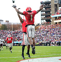 ATHENS, GA - NOVEMBER 23: George Pickens #1 of the Georgia Bulldogs celebrates after a touchdown during a game between Texas A