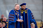 May 17, 2015; Rev. John I. Jenkins, C.S.C., president of the University of Notre Dame, presents the Laetare Medal to Aaron Neville, a four-time Grammy Award winning singer and musician, during the 2015 Commencement ceremonies in the Notre Dame Stadium.  (Photo by Barbara Johnston/University of Notre Dame)