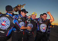 Nov 1, 2015; Las Vegas, NV, USA; NHRA funny car driver Robert Hight (center) celebrates with teammates after winning the Toyota Nationals at The Strip at Las Vegas Motor Speedway. Mandatory Credit: Mark J. Rebilas-USA TODAY Sports