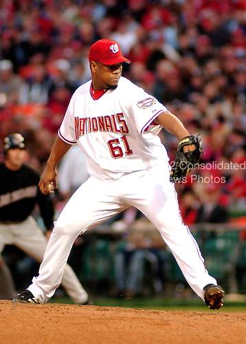 Washingon, D.C. - April 14, 2005 -- Washington Nationals pitcher Livon Hernandez (61) prepares winds up to pitch in game action against the Arizona Diamondbacks at RFK Stadium in Washington, D.C. on April 14, 2005..Credit: Ron Sachs / CNP.(RESTRICTION: NO New York or New Jersey Newspapers or newspapers within a 75 mile radius of New York City)