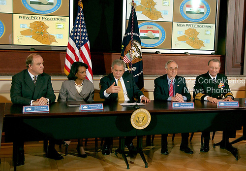 Washington, D.C. - March 22, 2007 -- United States President George W. Bush participates in a Roundtable with the Iraq Provincial Reconstruction Team (PRT) Leaders.  The President also announced the United States Secretary of State Condoleezza Rice would be returning to the Middle East to continue the administration's efforts to broker a peace agreement in the region. PRTs are joint civilian-military units that support local leaders and empower provincial authorities by working closely with the communities they serve.  The expansion is a joint Department of State-Department of Defense mission that will employ both civilian and military resources toward a common strategic plan.  From left to right: Ambassador Randall Tobias, USAID; Secretary Rice; President Bush; Deputy Secretary of Defense Gordon England; and Admiral Edmund Giambastiani, Vice Chairman of the Joint Chiefs of Staff.<br /> Credit: Ron Sachs - Pool