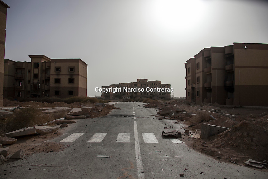 November 12, 2014 - Tawergha City, Libya: Abandoned residential buildings are seen partially destroyed in Tawergha City ghost town after heavy clashes occured during 2011 war in Libya when Tawerghans were forced to move from their city home as they were harassed by the armed militias of Misrata during the uprising against Colonel Gaddafi. (Photo/Narciso Contreras)