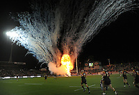 Pyrotechnics erupt as the Chiefs run onto the pitch during the Super 15 rugby match between the Chiefs and Hurricanes at Waikato Stadium, Hamilton, New Zealand on Saturday, 28 April 2011. Photo: Dave Lintott / lintottphoto.co.nz