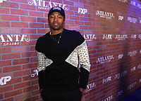"""LOS ANGELES - FEBRUARY 19: Malcolm Mays arrives at the red carpet event for FX's """"Atlanta Robbin' Season"""" at the Ace Theatre on February 19, 2018 in Los Angeles, California.(Photo by Frank Micelotta/FX/PictureGroup)"""