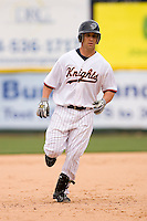 Keith Ginter #11 of the Charlotte Knights rounds the bases after hitting a home run at Knights Castle May 3, 2009 in Fort Mill, South Carolina. (Photo by Brian Westerholt / Four Seam Images)