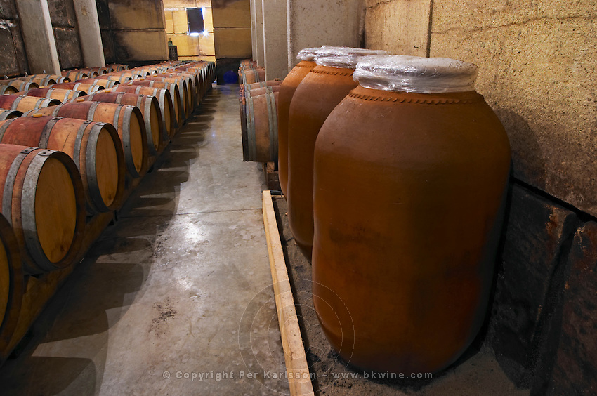 In the barrel aging cellar. Experiment with storing and aging wine in earthenware amphora, similar to what was done in Roman times. Domaine Viret, Saint Maurice sur Eygues, Drôme Drome France, Europe