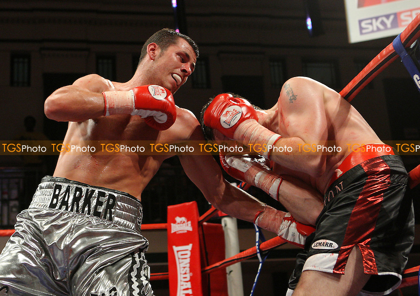 Darren Barker (Barnet, silver shorts) defeated Greg Barton (Southend, black shorts) after the referee stopped the fight in the third round - Middleweight boxing at York Hall, Bethnal Green promoted by Hennessy Sports - 05/10/07 - MANDATORY CREDIT: Gavin Ellis/TGSPHOTO. Self-Billing applies where appropriate. NO UNPAID USE. Tel: 0845 094 6026