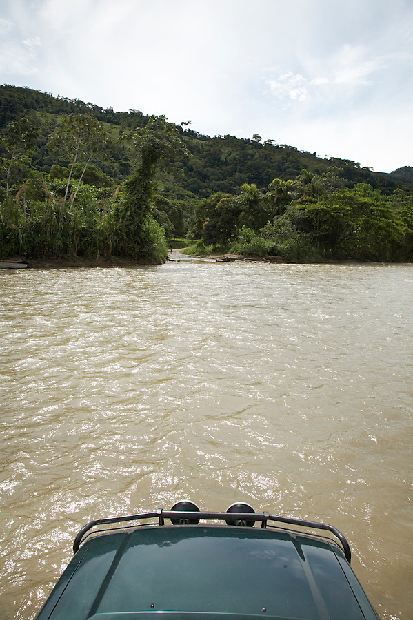 A four wheel-drive vehicle crossing the Chimate river in the Yungas region of Bolivia.