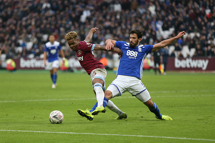 West Ham United's Grady Diangana and Birmingham City's Maxime Colin<br /> <br /> Photographer Rob Newell/CameraSport<br /> <br /> Emirates FA Cup Third Round - West Ham United v Birmingham City - Saturday 5th January 2019 - London Stadium - London<br />  <br /> World Copyright © 2019 CameraSport. All rights reserved. 43 Linden Ave. Countesthorpe. Leicester. England. LE8 5PG - Tel: +44 (0) 116 277 4147 - admin@camerasport.com - www.camerasport.com