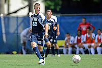 10 September 2011:  FIU's Quentin Albrecht (22) moves the ball upfield in the second half as the FIU Golden Panthers defeated the Stetson University Hatters, 3-2 in the second overtime period, at University Park Stadium in Miami, Florida.