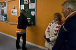 Blackpool 2 Liverpool 1, 12/01/2011. Bloomfield Road, Premier League. A member of the Blackpool Supporters' Association pinning information onto a board under the stand at the club's Bloomfield Road stadium before her club played host to Liverpool FC in a Premier League match. The home side won by two goals to one. It was the first time the clubs had met in a league match since Blackpool were last in the top division of English football in 1970-71. Photo by Colin McPherson.