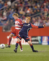 FC Dallas midfielder Dax McCarty (13) attempts to control the ball as New England Revolution midfielder/defender Jeff Larentowicz (13) challenges. The New England Revolution defeated FC Dallas, 2-1, at Gillette Stadium on April 4, 2009. Photo by Andrew Katsampes /isiphotos.com