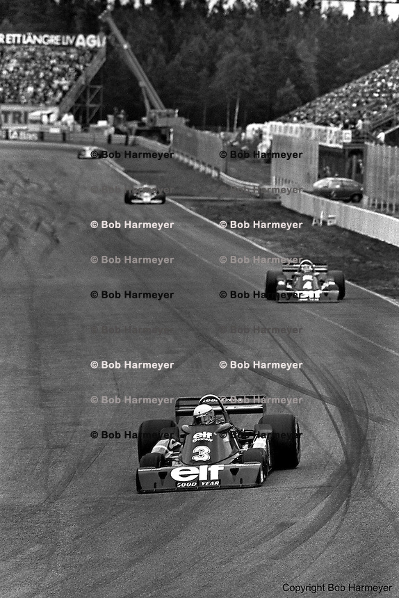 Teammates Jody Scheckter (#3) and Patrick Depailler (#4) lead the 1976 Grand Prix of Sweden at Anderstorp in their Tyrrell P34 six-wheel Formula 1 cars.