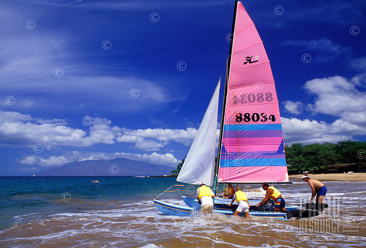Sailors launch a Hobie cat at Wailea beach, Maui