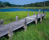 Wellfleet, Cape Cod, MA <br /> Weathered dock on Duck Creek, with Uncle Tim's bridge and Hamblin Park in the distance