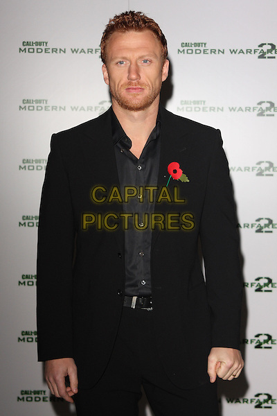 "KEVIN McKIDD .""Call Of Duty - Modern Warfare 2"" Video Game Launch at the Vue Cinema, Leicester Square, London, England, November 9th 2009..half length suit  beard facial hair poppy red black shirt .CAP/ROS.©Steve Ross/Capital Pictures."