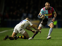 Harlequins' Ross Chisholm is tackled by Wasps' Marcus Watson<br /> <br /> Photographer Bob Bradford/CameraSport<br /> <br /> European Rugby Challenge Cup - Harlequins v Wasps - Sunday 13th January 2018 - Twickenham Stoop - London<br /> <br /> World Copyright &copy; 2018 CameraSport. All rights reserved. 43 Linden Ave. Countesthorpe. Leicester. England. LE8 5PG - Tel: +44 (0) 116 277 4147 - admin@camerasport.com - www.camerasport.com