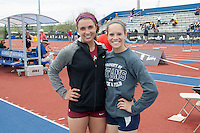 St. Charles West senior Morgan Griffiths (left) and Lee's Summit West junior Nicole Kallenberger pose for a photo after they and another competitor cleared 11-11.75 in the pole vault. Because of misses however, Griffiths finished third, and Kallenberger 2nd in the event at the 2015 Kansas Relays.