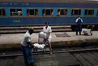 CAMAGUEY, CUBA - APRIL 5: Cuban passengers take off  with their bags at Camaguey train station during a trip from Havana to Santiago de Cuba on April 5, 2018.. in Cuba. Ferrocarriles de Cuba, is one of the oldest railroad around world, having opened its first route in 1837 with at least 17-mile long. Now the railway probably could cover more than 2,600 miles along the Island. (Photo by Eliana Aponte/VIEWpress)