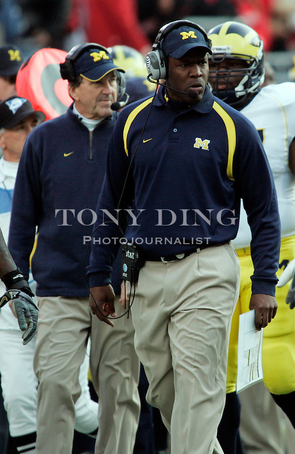 18 Nov 2006: Michigan head coach Lloyd Carr, left, and defensive coordinator Ron English, center, watch their team play during Ohio State's 42-39 win over Michigan in a college football game at Ohio Stadium in Columbus, OH.