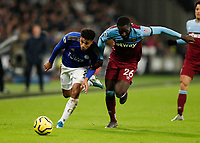 28th December 2019; London Stadium, London, England; English Premier League Football, West Ham United versus Leicester City; Arthur Masuaku of West Ham United challenges James Justin of Leicester City  - Strictly Editorial Use Only. No use with unauthorized audio, video, data, fixture lists, club/league logos or 'live' services. Online in-match use limited to 120 images, no video emulation. No use in betting, games or single club/league/player publications