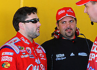 Feb 07, 2009; Daytona Beach, FL, USA; Darian Grubb (right) talks to NASCAR Sprint Cup Series driver Tony Stewart during practice for the Daytona 500 at Daytona International Speedway. Mandatory Credit: Mark J. Rebilas-