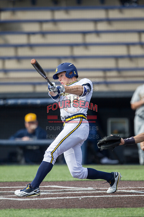 Michigan Wolverines outfielder Matt Ramsey (19) swings the bat against the Toledo Rockets on April 20, 2016 at Ray Fisher Stadium in Ann Arbor, Michigan. Michigan defeated Bowling Green 2-1. (Andrew Woolley/Four Seam Images)