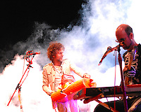 Lead Wayne Coyne controls the pyrotechnics (left) as Michael Ivins plays bass (right) at the Flaming Lips concert at the Alliant Energy Center's Willow Island Saturday night, 9/8/07