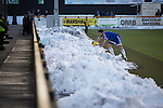 Alloa Athletic 0 Peterhead 1,14/01/2017. Recreation Park, Scottish League One. An away player retrieves the match ball from a pile of snow as Alloa Athletic take on Peterhead (in blue) in a Scottish League One fixture at Recreation Park, with the Ochil Hills in the background. The club was formed in 1878 as Clackmannan County, changing the name to Alloa Athletic in 1883. The visitors won the match by one goal to nil, watched by a crowd of 504. Photo by Colin McPherson.