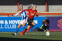 Alex Greenwood of Manchester United Women and Kirsty Barton of Brighton & Hove Albion Women during Brighton & Hove Albion Women vs Manchester United Women, SSE Women's FA Cup Football at Broadfield Stadium on 3rd February 2019