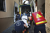 Switzerland. Canton Ticino. Bioggio. A senior woman lying down on an emergency medical stretcher is taking in the ambulance by a paramedics team. The elderly woman is suffering from drug poisoning for taking by mistake an overdose of prescribed drugs. The paramedics wear blue uniforms and work for the Croce Verde Lugano. The woman (C) and the man (C) are professional certified nurses, the woman (L) and the man (R) carrying the red bag are volunteers specifically trained in emergency rescue. The Croce Verde Lugano is a private organization which ensure health safety by addressing different emergencies services and rescue services. Volunteering is generally considered an altruistic activity where an individual provides services for no financial or social gain to benefit another person, group or organization. Volunteering is also renowned for skill development and is often intended to promote goodness or to improve human quality of life. 14.01.2018 © 2018 Didier Ruef
