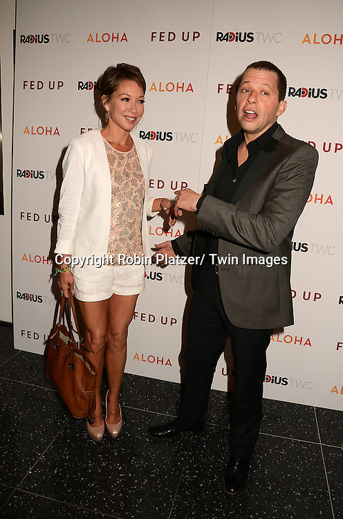 "Lisa Joyner and Jon Cryer attends the New York Premiere of ""FED UP"" on May 6, 2014 at The Museum of Modern Art in New York City."