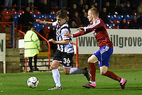Jordan Stewart of Grimsby Town is challenged by Sean McGinty of Aldershot Town during the Vanarama National League match between Aldershot Town and Grimsby Town at the EBB Stadium, Aldershot, England on 5 April 2016. Photo by Paul Paxford / PRiME Media Images.