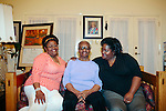 Lisa McNair (left to right) sits next to her mother Maxine and sister Kimberly Brock in her Birmingham, Alabama home August 13, 2013. Lisa's sister Denise McNair was the youngest victim who died in a bomb blast at 16th Street Baptist Church September 15, 1963.