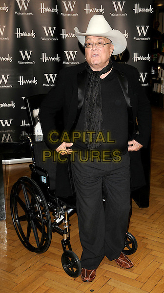 """TONY CURTIS.Booksigning of his autobiography """"American Prince: My Autobiography"""", Harrods, London, England..October 21st, 2008.book signing full glasses cream white stetson cowboy hat  black scarf wheelchair jacket top grey gray trousers .CAP/CAN.©Can Nguyen/Capital Pictures"""