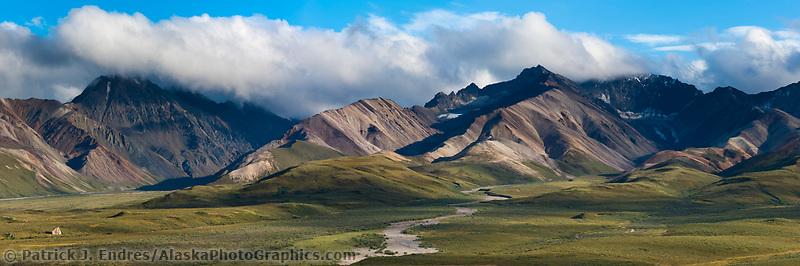 Evening light on the colorful Polychrome mountains of the Alaska Range in Denali National Park, Interior, Alaska.