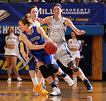 BROOKINGS, SD - MARCH 23:  Sarah Nelson #42 from Creighton tries to escape the double team of Gabbie Boever #4 and Megan Waytashek #24 from South Dakota State in the first half of their WNIT game Sunday afternoon at Frost Arena in Brookings. (Photo by Dave Eggen/Inertia)