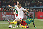 19 JUN 2010: Lars Jacobsen (DEN) (6) and Achille Emana (CMR) (10). The Denmark National Team defeated the Cameroon National Team 2-1 at Loftus Versfeld Stadium in Tshwane/Pretoria, South Africa in a 2010 FIFA World Cup Group E match.