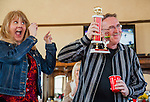 Third place winner in the Spam eating contest, Michale Kennedy, of Antioch, shows off his trophy at the Isleton Spam Festival at Peter's Steakhouse in Isleton, California, on Sunday, February, 16th, 2014.  Photo/Victoria Sheridan