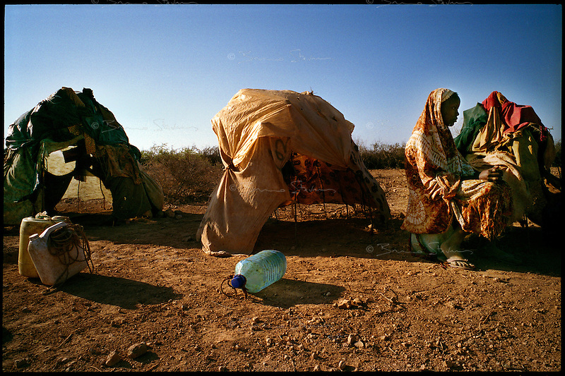 Wajid, Somalia, March 2006..Said Mohammed, 18. She is amongst 'new arrivals' in Leheley IDP camp, home to thousands of 'drop-outs', semi-nomadic herdsmen who are leaving the bush to come and live in camps near villages as their livestock is decimated by a persistent drought, abandonning their traditional lifestyle.