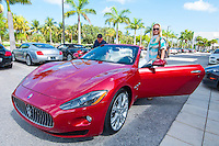 Sandra Kaseta and Richie Rodriguez ready for a test drive along the Tamiami Trail in  a Maserati for sale at Luxury Imports of Naples, 900 Tamiami Trail, Naples, Florida, USA, July 20, 2012. Photo by Debi Pittman Wilkey, CoastalLife.com.