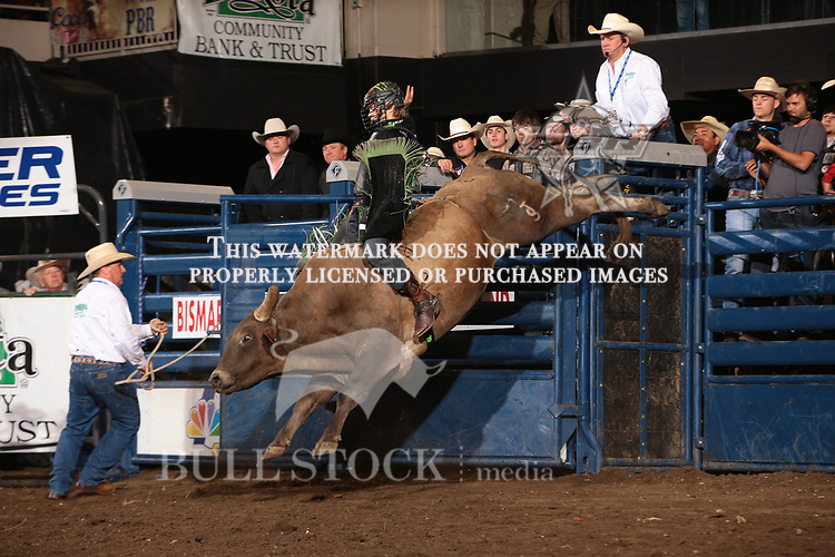 Derek Kolbaba rides Dakota Rodeo/chad Berger/Clay Struve/H&C Bucking Bulls's Beast of Burden for 89.5 during the second round of the Bismarck Real Time Pain Relief Velocity tour PBR. Photo by Andy Watson