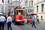 Street car with conductor and pedestrians on Taksim district of Istanbul, Turkey