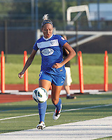 Boston Breakers forward Kyah Simon (17) brings the ball forward.  In a National Women's Soccer League (NWSL) match, Boston Breakers (blue) tied Western New York Flash (white), 2-2, at Dilboy Stadium on August 3, 2013.