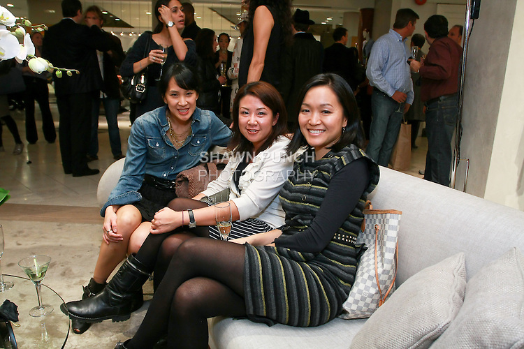 Guests attend the Elie Tahari Boutique opening at Saks Fifth Avenue, October 19, 2010.